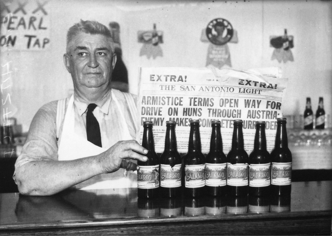 E.M. Hitzfelder pulls old Alamo beer from his storeroom, which was packed in the November 4, 1918 edition San Antonio Light to showcase the legalization of the sale of 3.2% beer September 26, 1933.  By the fourth year of the Great Depression I would imagine that everyone needed a drink. | Drink up the history with The Barwalk, San Antonio TX