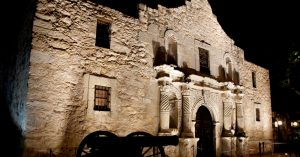 Alamo at night with battle cannon