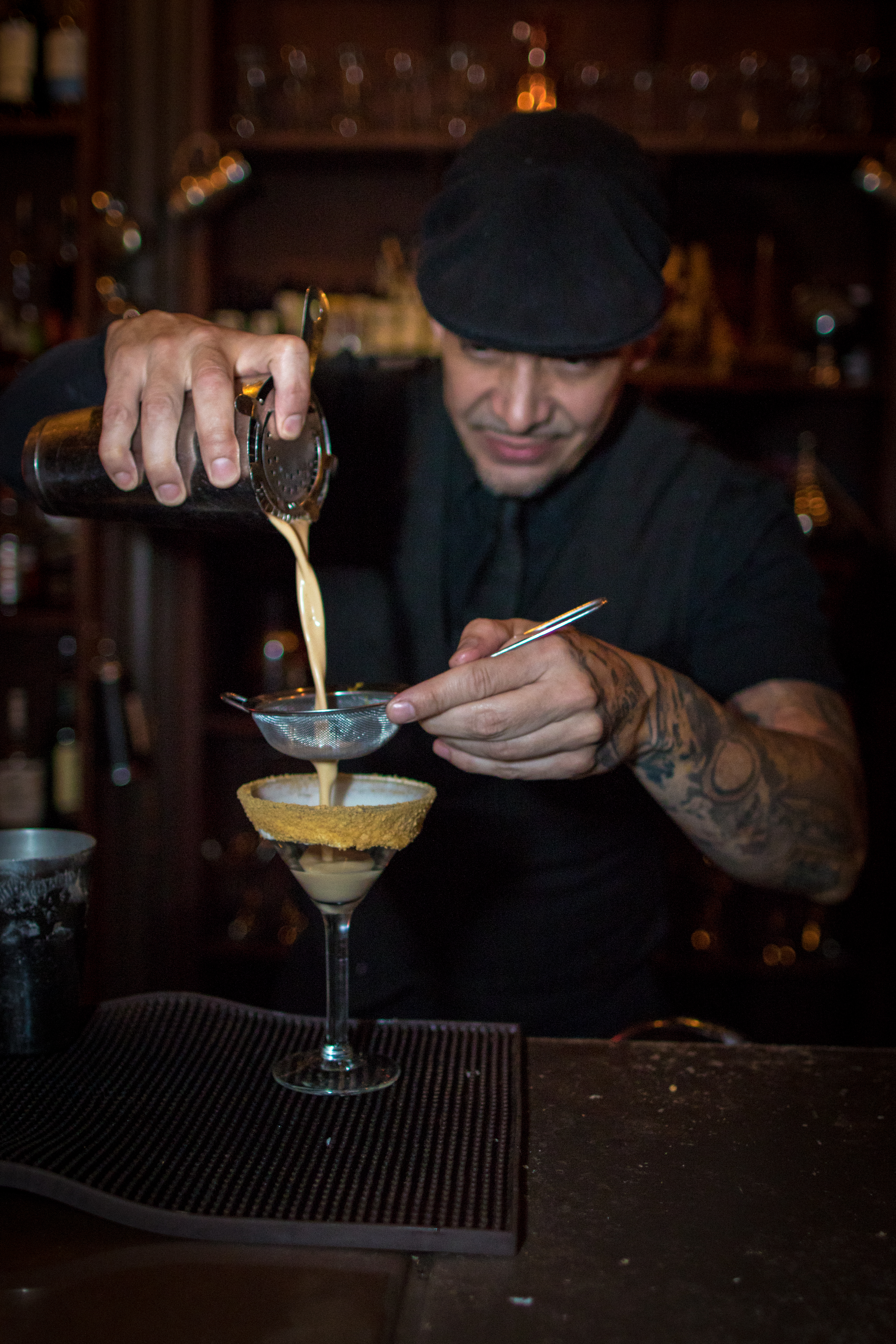 Pouring a dessert cocktail on historic bar tour